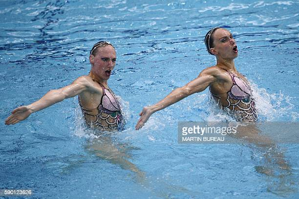 Russia's Natalia Ishchenko and Russia's Svetlana Romashina compete in the Duets Technical Routine final during the synchronised swimming event at the...