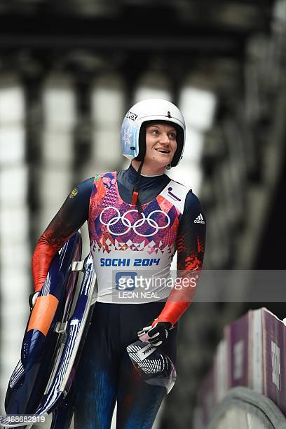 Russia's Natalia Khoreva reacts at the end of her Women's Luge Singles event final run at the Sanki Sliding Center during the Sochi Winter Olympics...