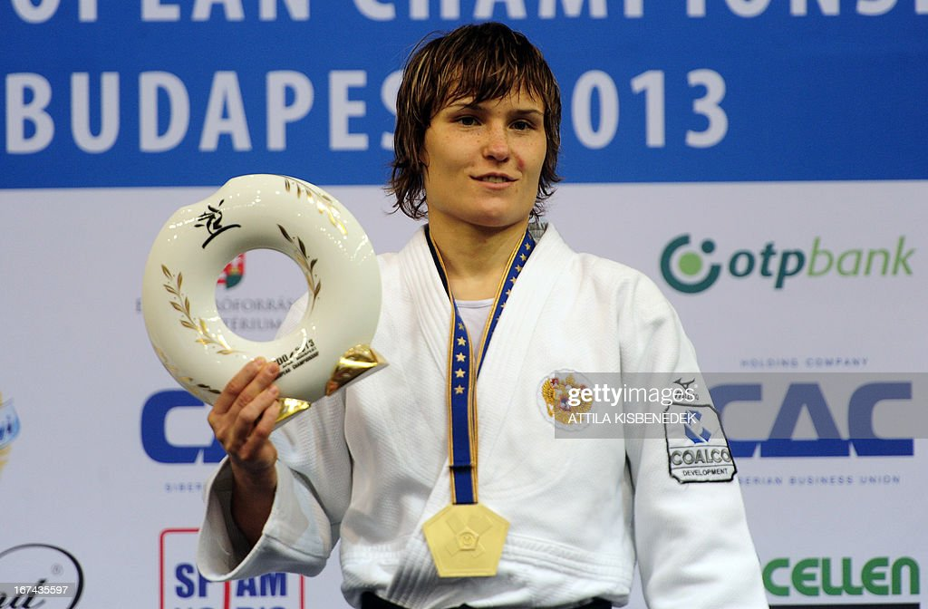 Russia's Natalia Kiziutina celebrates her gold medal on the podium over Romania's Andreea Chitu (not pictures) during the medal ceremony of the Judo European Championships in 52kg category for women in Budapest.