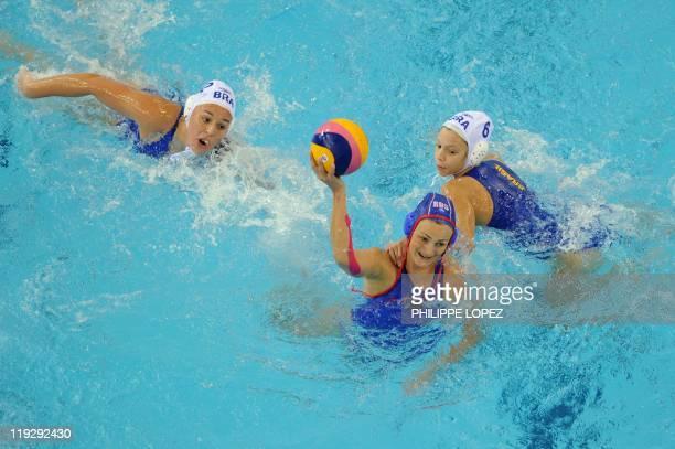 Russia's Natalia RyshovaAlenicheva Brazil's Cecilia Canetti and Brazil's Gabriela Leme Gozani compete in their group C women's water polo preliminary...