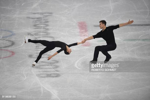 Russia's Natalia Zabiiako and Alexander Enbert perform a routine during a practice session at the Gangneung Ice Arena ahead of the pairs figure...