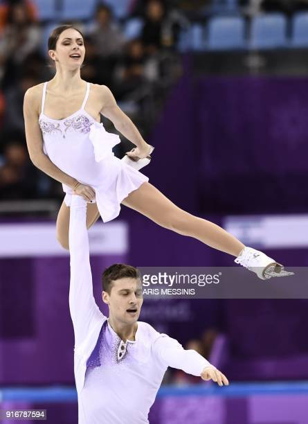 Russia's Natalia Zabiiako and Russia's Alexander Enbert compete in the figure skating team event pair skating free skating during the Pyeongchang...