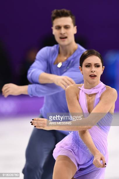 Russia's Natalia Zabiiako and Russia's Alexander Enbert compete in the pair skating short program of the figure skating event during the Pyeongchang...