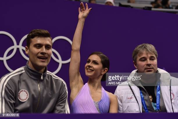 Russia's Natalia Zabiiako and Russia's Alexander Enbert react after competing in the pair skating short program of the figure skating event during...