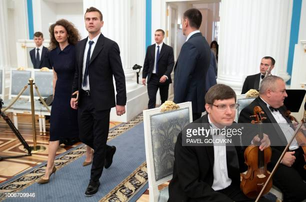 Russia's national football team goalkeeper Igor Akinfeev and his wife Ekaterina enter a hall prior to an awards ceremony for the team at the Kremlin...