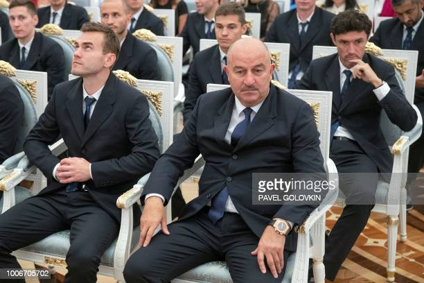 Russia's national football team goalkeeper Igor Akinfeev coach Stanislav Cherchesov and Yuri Zhirkov wait for the beginning of an awards ceremony for...