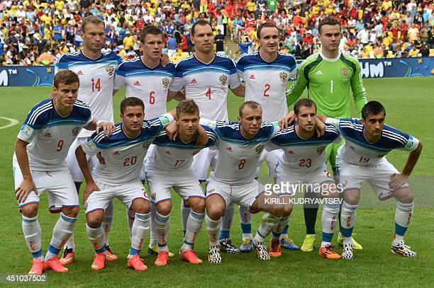 Russia's national team players Russia's defender Vasily BerezutskyRussia's forward Maxim Kanunnikov Russia's defender and captain Sergey Ignashevich...