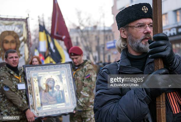 Russia's nationalists supporters take part in a march in Moscow's Shchukino suburb on November 4 during National Unity Day a national holiday which...