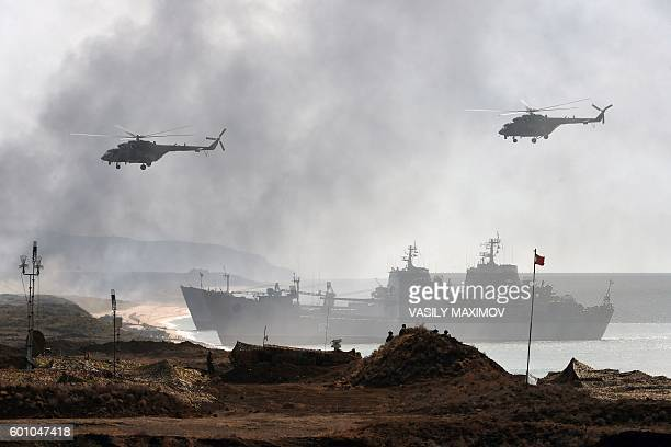 Russia's navy ships and helicopters take part in a military exercise called Kavkaz 2016 at the coast of the Black Sea in Crimea on September 9, 2016....