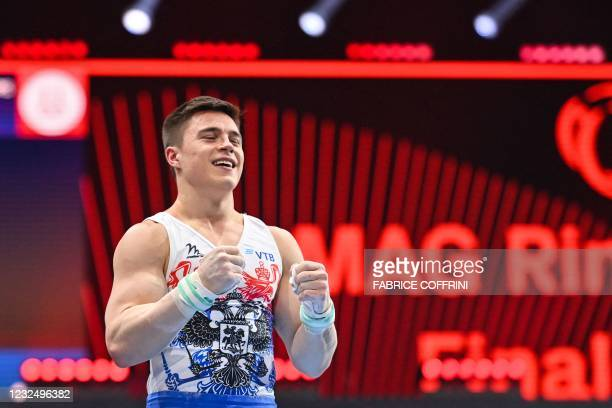 Russia's Nikita Nagornyy reacts as he competes in the Men's rings apparatus final of the 2021 European Artistic Gymnastics Championships at the St...