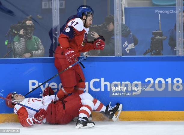 TOPSHOT Russia's Nikolai Prokhorkin and Czech Republic's Jakub Nakladal clash in the men's semifinal ice hockey match between the Czech Republic and...