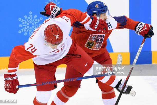 Russia's Nikolai Prokhorkin and Czech Republic's Jan Kovar collide in the men's semifinal ice hockey match between the Czech Republic and the Olympic...