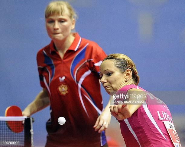 Russia's Oksana Fadeeva looks up as her teammate Lithuania's Ruta Paskauskiene returns a ball against Romania's Elizabeta Samara and Daniela Dodean...