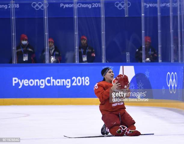 TOPSHOT Russia's Olga Sosina falls to the ice in the women's bronze medal ice hockey match between Finland and the Olympic Athletes from Russia...