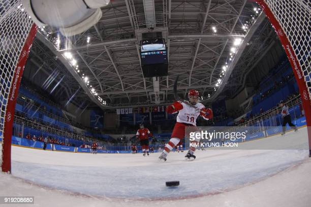 Russia's Olga Sosina scores an open net goal in the women's quarter-final ice hockey match between the Olympic Athletes from Russia and Switzerland...
