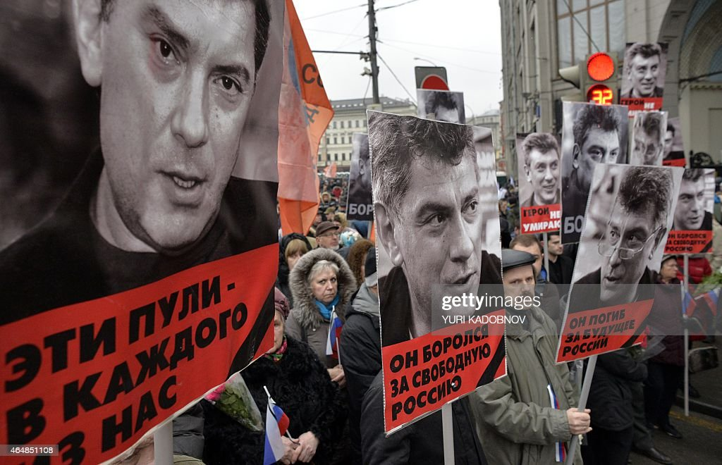 Russia's opposition supporters carry portraits of Kremlin critic Boris Nemtsov during a march in central Moscow on March 1, 2015. Words under portraits read ''Those bullets for everyone of us', 'He fought for a free Russia', 'He died for the future of Russia'. The 55-year-old former first deputy prime minister under Boris Yeltsin was shot in the back several times just before midnight on February 27 as he walked across a bridge a stone's throw from the Kremlin walls.