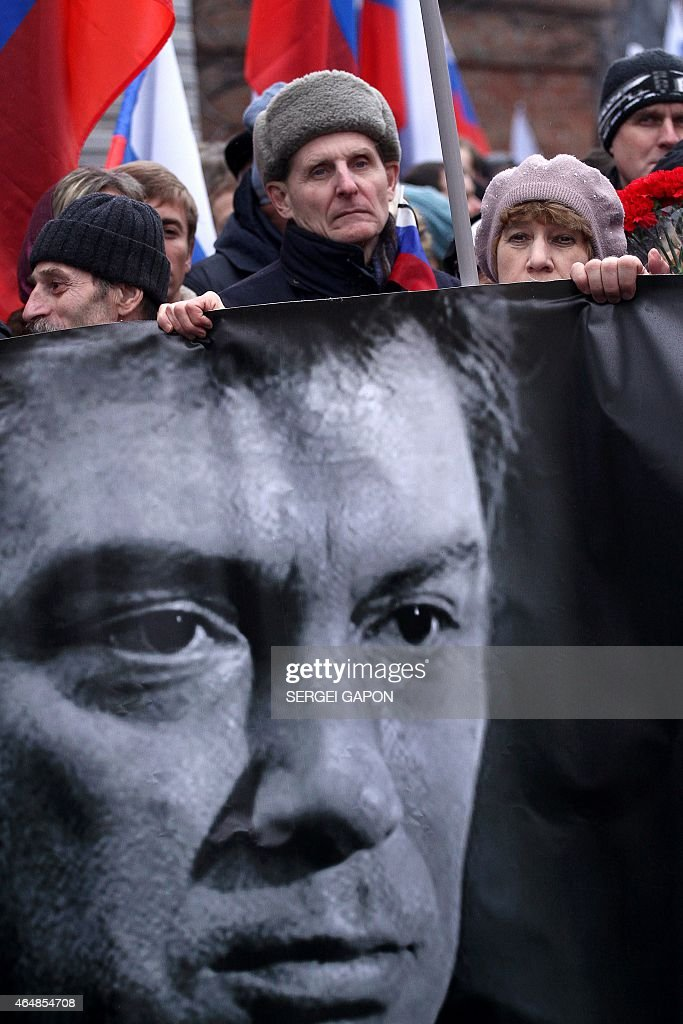 Russia's opposition supporters hold a banner bearing a portrait of Kremlin critic Boris Nemtsov during a march in central Moscow on March 1, 2015. The 55-year-old former first deputy prime minister under Boris Yeltsin was shot in the back several times just before midnight on February 27 as he walked across a bridge a stone's throw from the Kremlin walls.