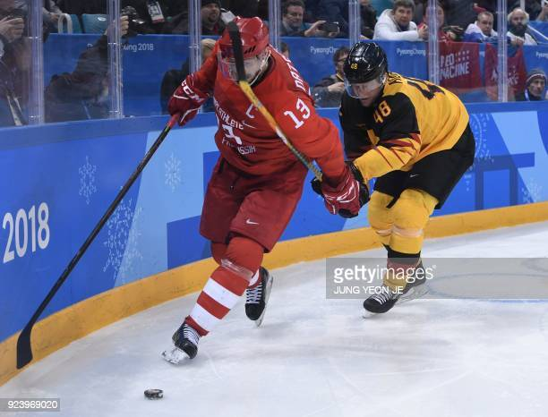 Russia's Pavel Datsyuk and Germany's Frank Hordler vie for the puck in the men's gold medal ice hockey match between the Olympic Athletes from Russia...