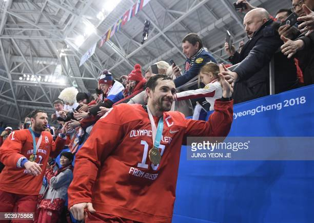 Russia's Pavel Datsyuk greets fans after the medal ceremony after they won the men's gold medal ice hockey match between the Olympic Athletes from...