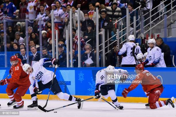 Russia's Pavel Datsyuk US Troy Terry US Ryan Donato and Russia's Kirill Kaprizov vie for the puck in the men's ice hockey preliminary round group B...