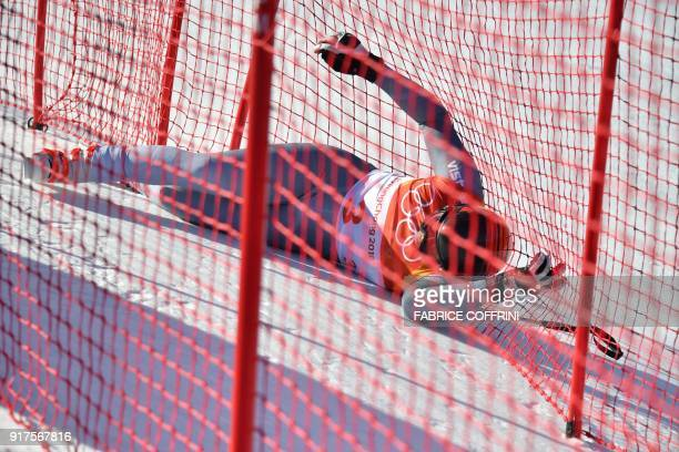 Russia's Pavel Trikhichev lies on the snow after a fall during the Men's Alpine Combined Downhill at the Jeongseon Alpine Center during the...
