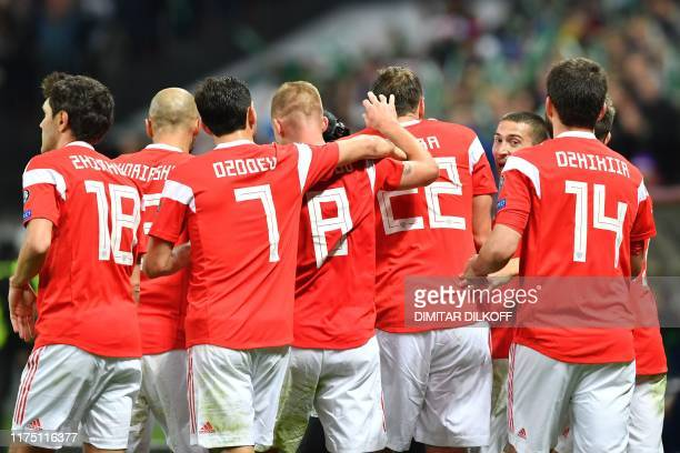 Russia's players celebrate a goal during the Euro 2020 football qualification match between Russia and Scotland at the Luzhniki stadium in Moscow on...