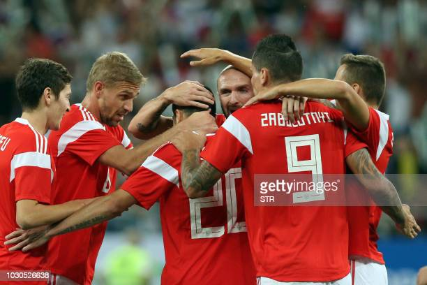 Russia's players celebrate a goal during the international friendly football match between Russia and Czech Republic at the Rostov Arena in...