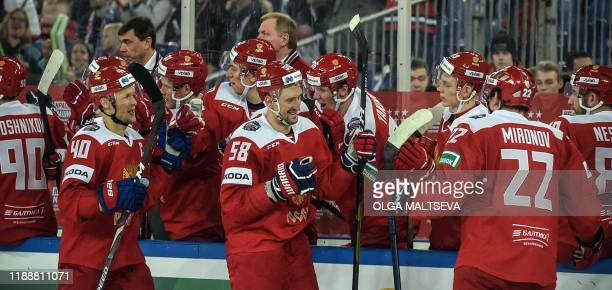 Russia's players celebrate after scoring during the Channel One Cup of the Euro Hockey Tour ice hockey match between Russia and Finland at football...