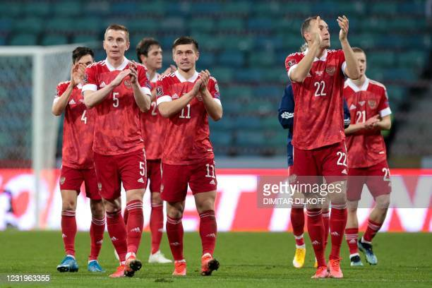 Russia's players celebrate after the FIFA World Cup Qatar 2022 qualification football match Russia v Slovenia at the Fisht Stadium in Sochi on March...