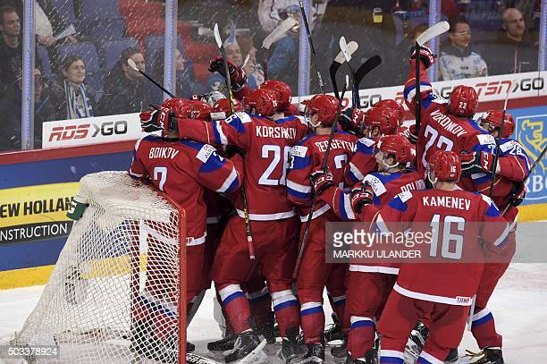 Russia's players celebrate after winning the 2016 IIHF World Junior Ice Hockey Championship semifinal match between Russia and USA in Helsinki...