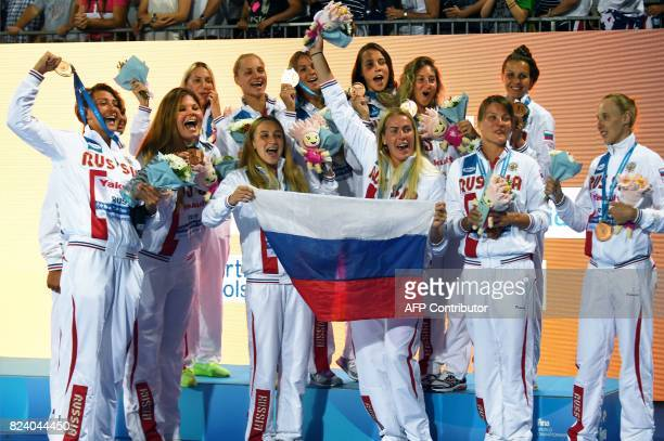 Russia's players celebrate after winning the women's bronze medal water polo match between Russia and Canada during the FINA2017 world championships...
