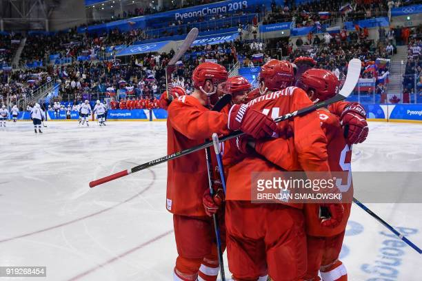 TOPSHOT Russia's players celebrate in the men's ice hockey preliminary round group B game between the Olympic Athletes from Russia and the United...