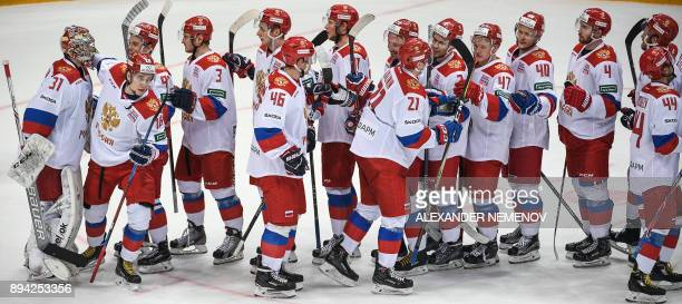 Russia's players celebrate their 30 victory during the Channel One Cup of the Euro Hockey Tour ice hockey match between Russia and Finland in Moscow...