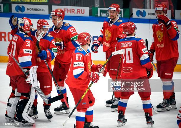 Russia's players celebrate their victory with a 4-3 penalty shootout during the Channel One Cup of the Euro Hockey Tour ice hockey match between...