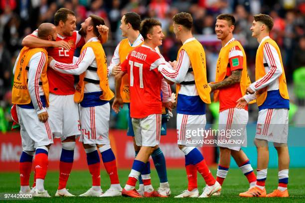 Russia's players including goal scorers forward Artem Dzyuba and midfielder Aleksandr Golovin celebrate after the Russia 2018 World Cup Group A...