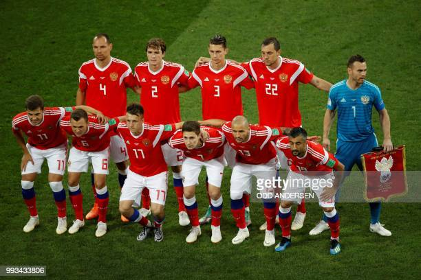 Russia's players pose ahead of the Russia 2018 World Cup quarterfinal football match between Russia and Croatia at the Fisht Stadium in Sochi on July...
