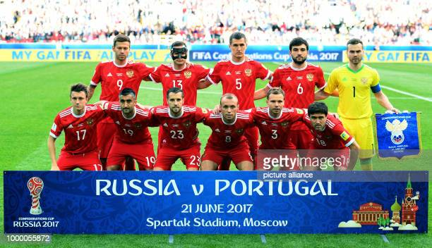 Russia's players pose for a group photograph before the preliminary stage group A match between Russia and Portugal in the Spartak Stadium in Moscow...