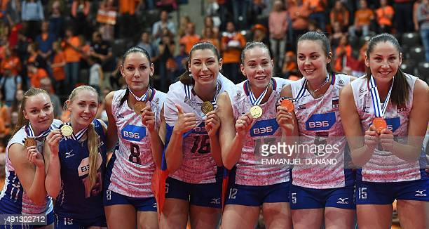 Russia's players present their gold medals as they celebrate on the podium after winning the Women's EuroVolley 2015 final match between The...