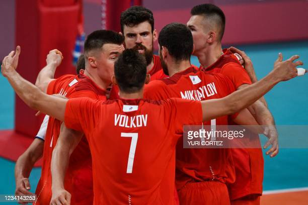 Russia's players rather in a huddle in the men's preliminary round pool B volleyball match between Russia and Argentina during the Tokyo 2020 Olympic...
