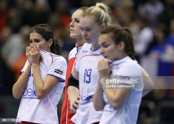 Russia's players react after they lost the IHF Womens World Championship handball quater final match between Norway and Russia on December 13 2017 in...