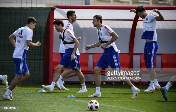 Russia's players take part in a training session in Novogorsk outside Moscow on June 29 ahead of the Russia 2018 World Cup round of 16 football match...