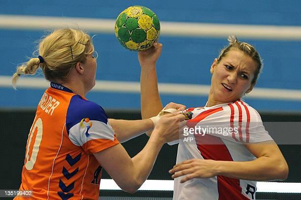 Russia's Polina Kuznetcova is blocked by Netherlands' Danick Snelder during their Women's World Handball Championship match in Barueri of Sao Paulo...
