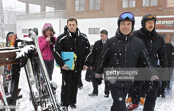 Russia's President Dmitry Medvedev and Azerbaijan's President Ilham Aliev walk during their informal meeting in Krasnaya Polyana near the Russian...
