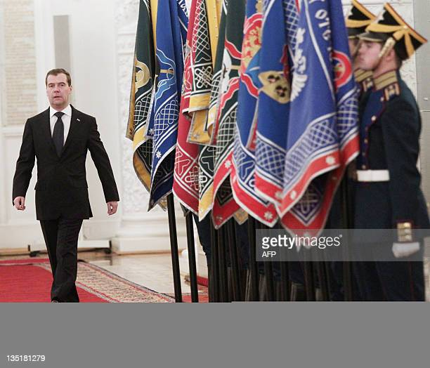 Russia's President Dmitry Medvedev arrives in Georgiyevsky Hall of the Big Kremlin Palace in Moscow on December 7 to take part in a ceremony to hand...