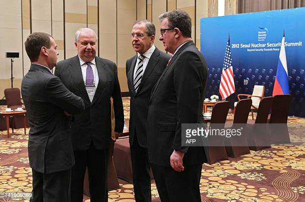 Russia's President Dmitry Medvedev confers with his foreign policy aide Sergei Prikhodko Foreign Minister Sergei Lavrov and Russian Ambassador to the...