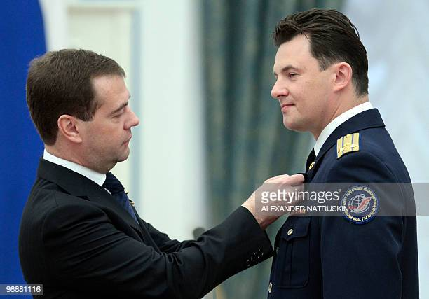 Russia's President Dmitry Medvedev decorates Roman Romanenko a Russian cosmonaut with the order Hero of Russia during an award ceremony in Moscow's...