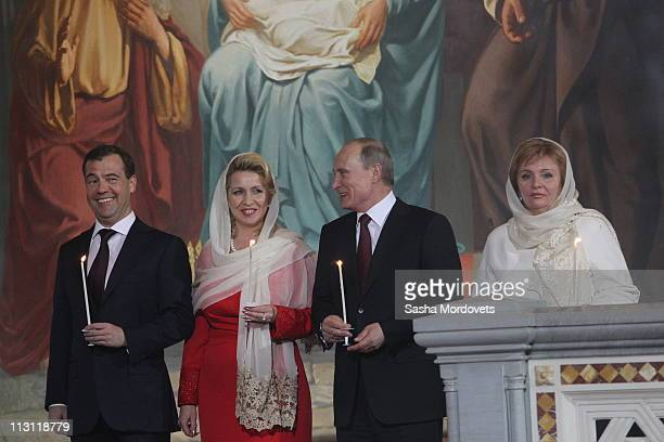 Russia's President Dmitry Medvedev first lady Svetlana Prime Minister Vladimir Putin and his wife Lyudmila pray during an Orthodox Easter service in...