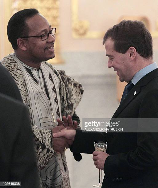 Russia's President Dmitry Medvedev shakes hands with Gambia's newlyappointed Ambassador Moses Benjamin Jallow during a ceremony at the Kremlin in...