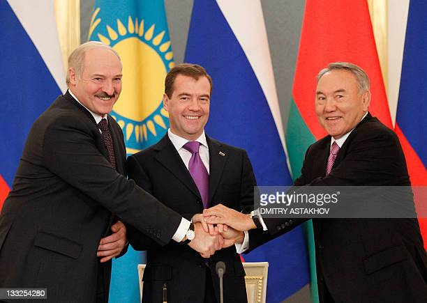 Russia's President Dmitry Medvedev shakes hands with his Kazakhstan and Belarus counterparts Nursultan Nazarbayev and Alexander Lukashenko as they...