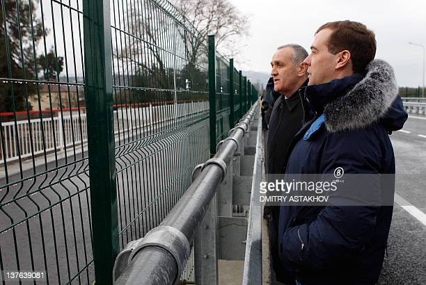 Russia's President Dmitry Medvedev speaks with Alexander Ankvab President of the Georgia's breakaway region of Abkhazia as they meet at a checkpoint...